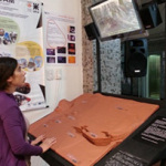 """Girl explores the """"Surface of Mars"""" model"""