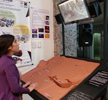 "Girl explores the ""Surface of Mars"" model"